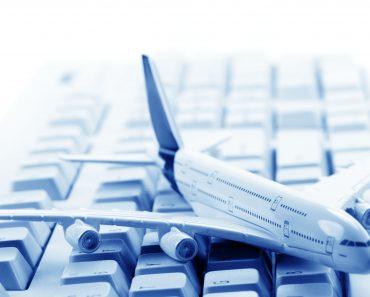 Model plane on computer keyboard